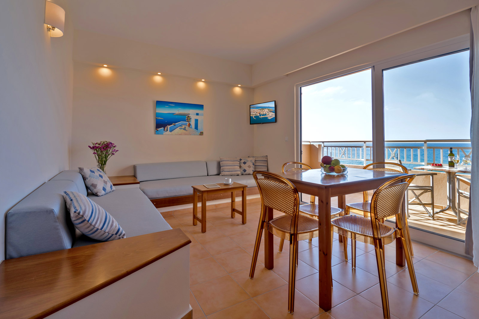 Suite roomwith sea view balconi, sofa and table