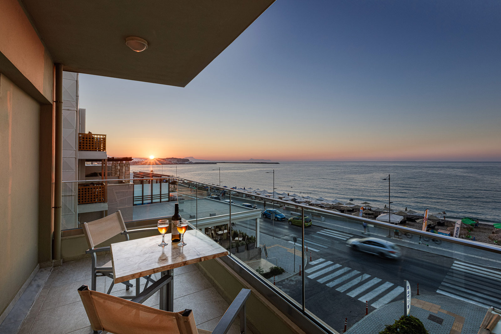 Hotel Balcony by sunset, table of wine with sea view
